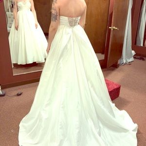 Wedding dress altered to size 2.. added gems/lace